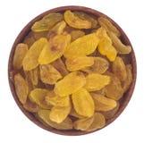 Raisins secs dans une cuvette en bois Photos libres de droits