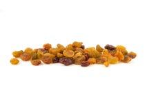 Raisins secs secs sur un fond blanc Photographie stock