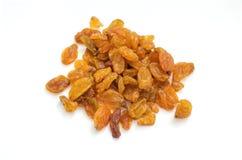 Raisins secs secs sur un fond blanc Images stock