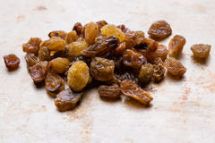 Raisins on steel plate Royalty Free Stock Photo