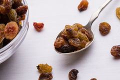 Raisins on steel spoon Royalty Free Stock Images