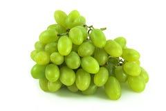 Raisins verts sur le blanc Photographie stock