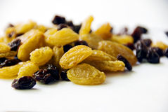 Raisins. Raisins on the white background royalty free stock image
