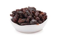 Raisins on a white background. Stock Photos