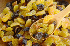 Raisins on wood table Royalty Free Stock Photography