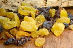 Raisins on wood table. Close up at raisins on wood table Royalty Free Stock Images