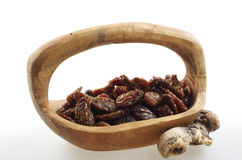 Raisins in a wooden bowl. Royalty Free Stock Image