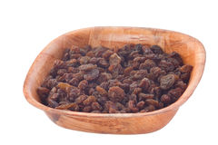 Raisins in wooden plate. Stock Photography