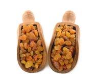 Raisins in a wooden scoop Stock Photo
