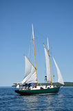 Raisng a Sail on a Schooner Sailboat Royalty Free Stock Photo