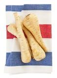Raizes da pastinaga na toalha de cozinha Imagem de Stock
