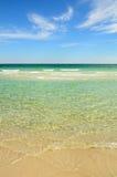 Raj plaża z jasną wodą Obrazy Royalty Free