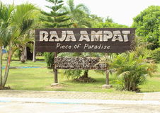 Raja Ampat Piece of Paradise. Name board of Raja Ampat in the ferry harbor, Waisai. Waigeo Island, Raja Ampat, West Papua. The Four Kings or the Raja Ampat Stock Images