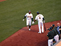 Raja Davis reaches to slap hands with Coco Crisp Stock Images