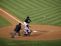 Rajai Davis begins to swing at incoming pitch Royalty Free Stock Photography