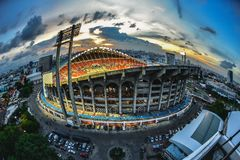 Rajamangala Stadium in Bangkok,Thailand.Downtown city in twiligh. T with reflection on June 3, 2016 Royalty Free Stock Photo