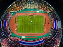 Rajamangala Stadium is the largest in the country in Bangkok,Tha. Iland.Downtown city in twilight with reflection.A public place where people can exercise and Royalty Free Stock Photo