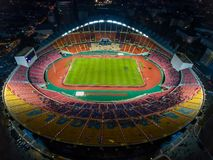 Rajamangala Stadium is the largest in the country in Bangkok,Tha. Iland.Downtown city in twilight with reflection.A public place where people can exercise and Royalty Free Stock Photography