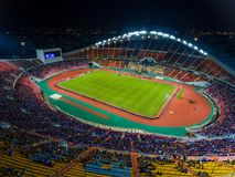 Rajamangala Stadium is the largest in the country in Bangkok,Tha. Iland.Downtown city in twilight with reflection.A public place where people can exercise and Stock Image
