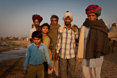 Rajastani men standing near a creek Stock Image
