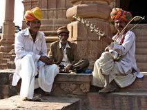 RAJASTANI MUSICIAN. TRADITIONALY DRESSED FOLK MUSICIANS ARE waiting WITH MUSICAL INSTRUMENTS FOR TOURISTS AT RAJASHTHAN, INDIA Royalty Free Stock Images