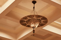 Rajasthan India Retro indigenous light fitting. With architectural detailing of straight lines of concrete boxing on ceiling Royalty Free Stock Photography