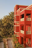 Rajasthan India three storey architecture. Portrait of generic modern architeture of 3 storey concrete block, brightly colored, blue sky and garden layout Stock Photos
