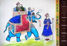 Rajasthan painting on Haveli. Traditional Rajasthan painting on the house wall of king riding on the blue elephant in Udaipur, Rajasthan, India Royalty Free Stock Photos