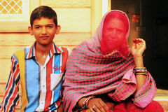 Rajasthan woman with her son. In front of their house at the village in Nagaur district Stock Photo