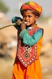 Rajasthani boy enjoying sugarcane Stock Images