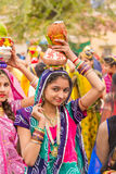 Rajasthani girl carrying a pot Royalty Free Stock Images