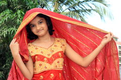 Rajasthani girl with traditional red dress Stock Photo