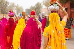 Rajasthani girls carrying pots Stock Photos