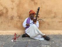 Rajasthani local  man playing ektara a music instrument