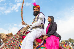 Rajasthani man and girl on a camel Royalty Free Stock Photo