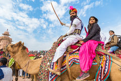 Rajasthani man and girl on a camel Royalty Free Stock Photography
