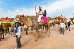 Rajasthani man and girl on a camel Royalty Free Stock Image