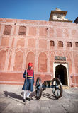 Rajasthani Man in turban near the cannon Royalty Free Stock Photo