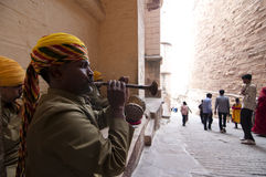 Rajasthani musicians. Playing their music instruments sitting inside Mehrangarh Fort Royalty Free Stock Image