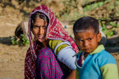 Rajasthani poor woman and her young son Stock Images