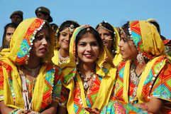 Rajasthani school girls are preparing to dance perfomance at Pushkar camel fair stock photography