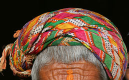Rajasthani turban, India. A very colorful Rajasthani turban worn by an old villager in India Royalty Free Stock Images
