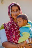 Rajasthani woman holding her young son Royalty Free Stock Images