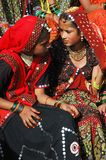 Rajasthani young women  are preparing to dance  at camel fair holiday,India Royalty Free Stock Photo