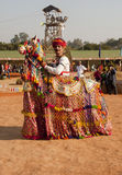Rajathani folk artist. A rajasthani folk dancer in the traditional colorfull free at the art and craft festival being held at kalagram panchkula, India. The Stock Photography
