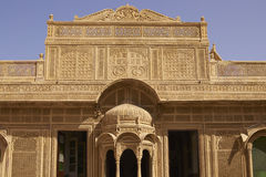 Rajput Architecture in Jaisalmer, India. Intricately carved facade of the honey coloured Jawahar Vilas Palace in the desert city of Jaisalmer in Rajasthan, India Stock Photography
