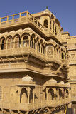 Rajput Architecture in Jaisalmer, India. Intricately carved walls and balconies of the honey coloured Jaisalmer Palace in Jaisalmer Fort in Rajasthan, India Royalty Free Stock Photography