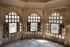 Rajput Palace in Rajasthan. Beautifully architectured balcony inside Amber Fort overlooking the lush green Aravalli hill range in Jaipur, Rajasthan. The artwork Royalty Free Stock Photos