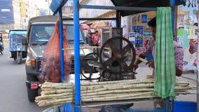 Street sugar cane juice maker in Rajshahi, Bangladesh. RAJSHAHI, BANGLADESH - NOVEMBER 9, 2016: Street sugar cane juice maker in Rajshahi, Bangladesh stock video