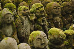 The Rakan of Otagi Nenbutsu-ji. Rakan (stone statues representing Buddhas disciples) at Otagi Nenbutsu Temple in the Arashiyama district of Kyoto, Japan. The Royalty Free Stock Photo
